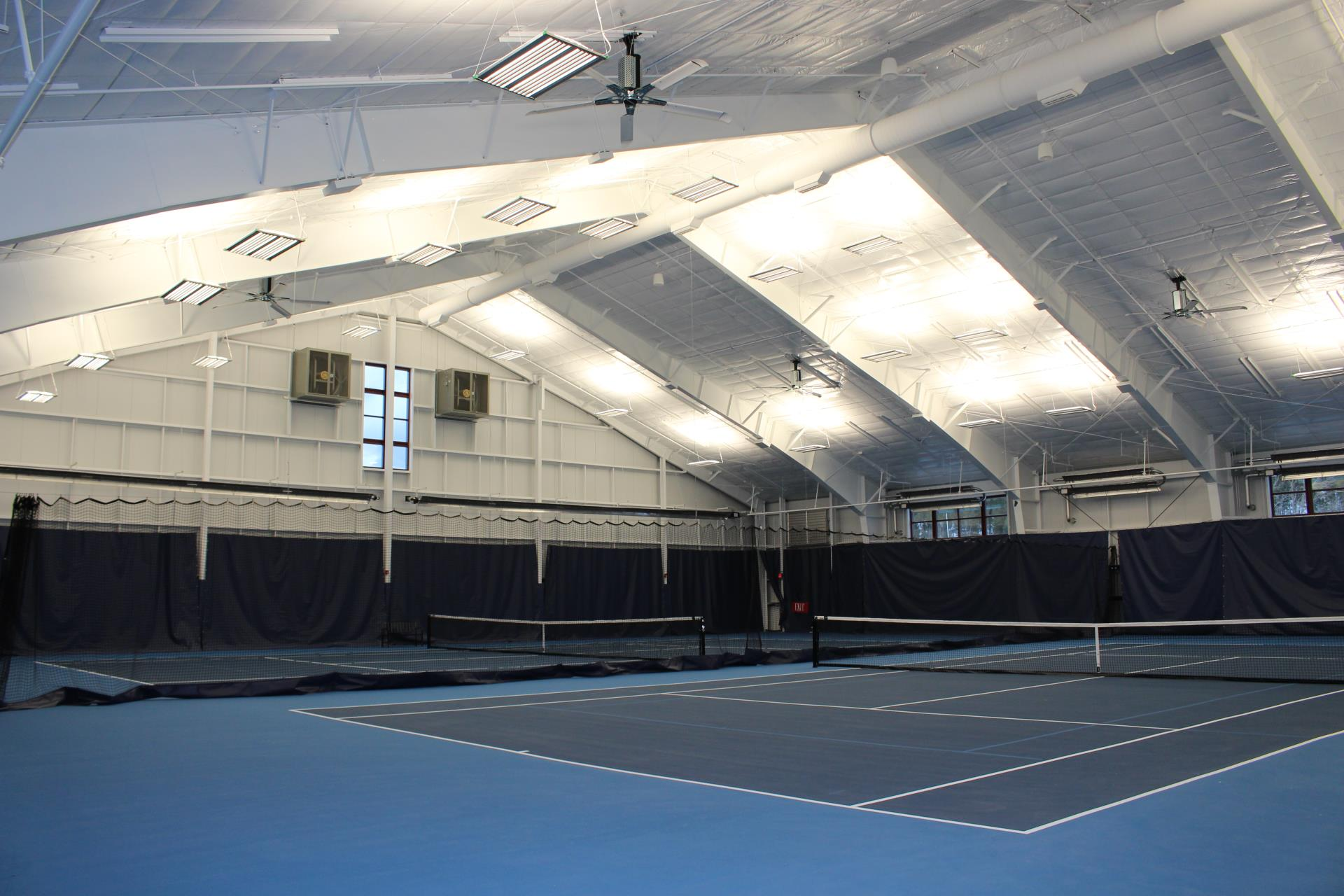 Interior of Breckenridge Tennis Center with two blue tennis courts