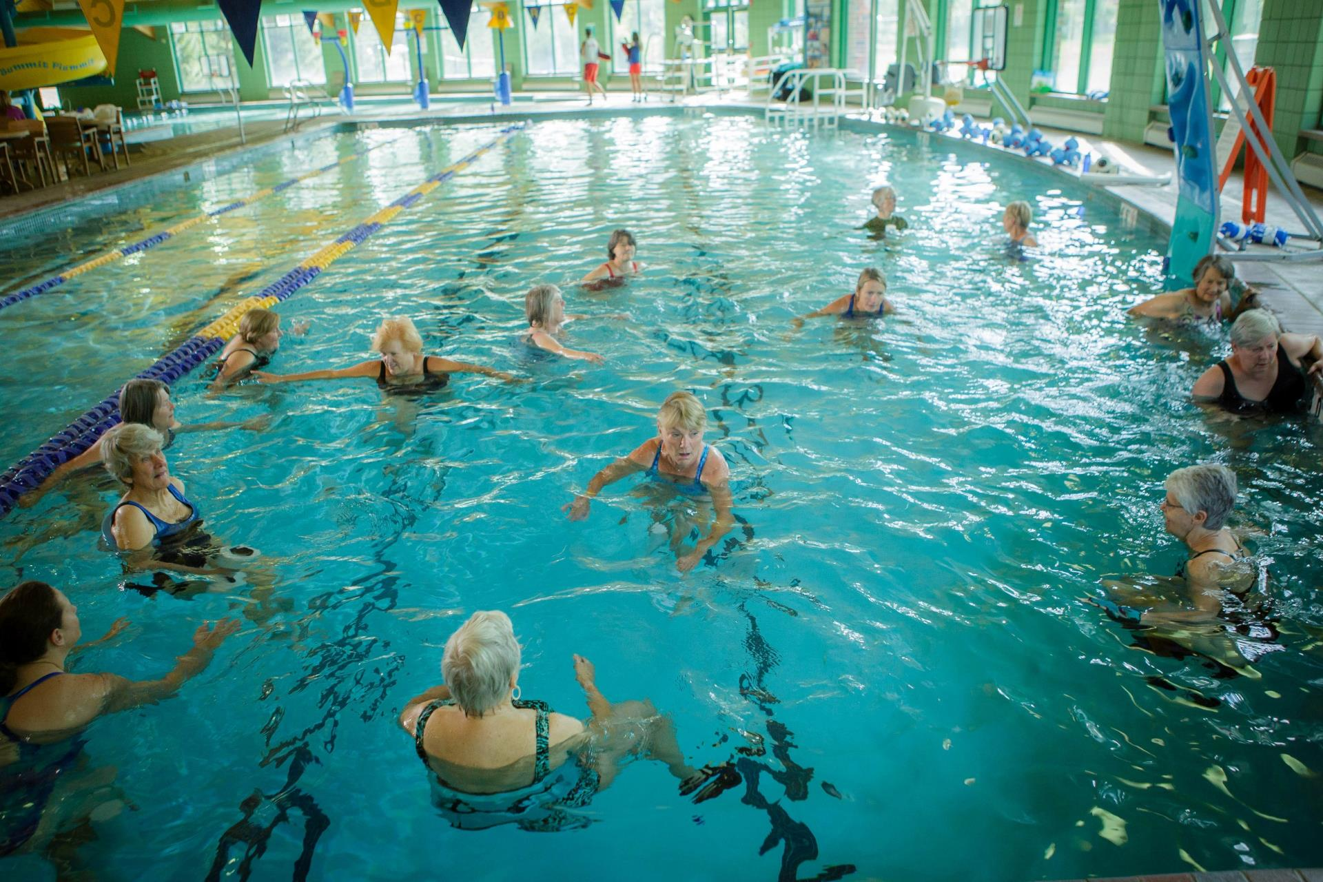 Large group of women in pool for water aerobics class