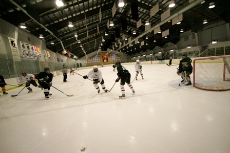 Wide view of hockey game at Stephen C. West Ice Arena