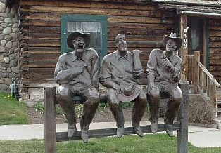 Statue of 3 cowboys outside of Daniels Cabin