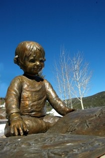 My Book - Statue of a little boy reading his book
