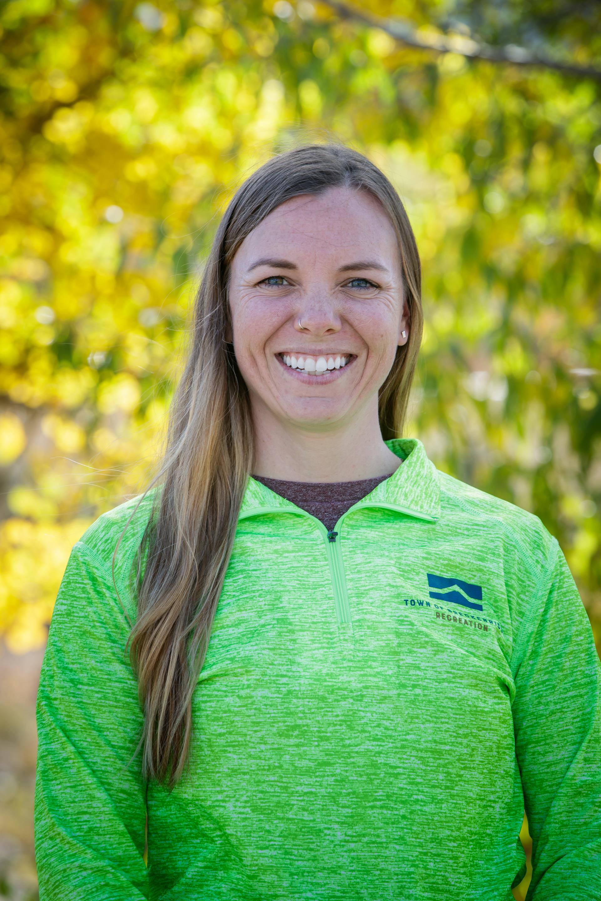 Head shot of Kelly Gerken Breckenridge Personal Trainer in blue staff shirt