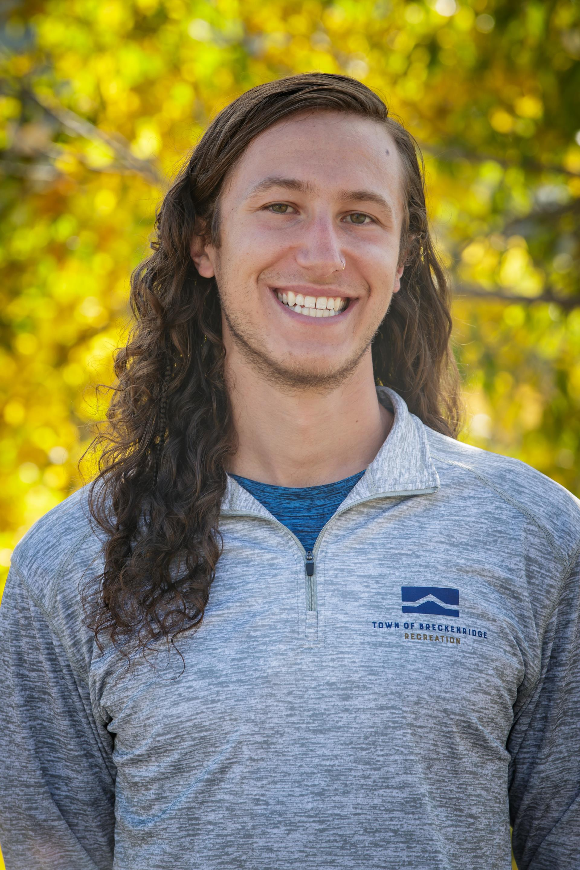 Head shot of Blake Veath Breckenridge personal trainer in blue staff shirt