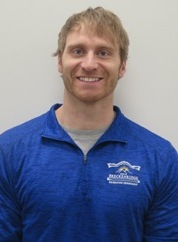Head shot of Jonny Henkins Breckenridge personal trainer in blue staff shirt