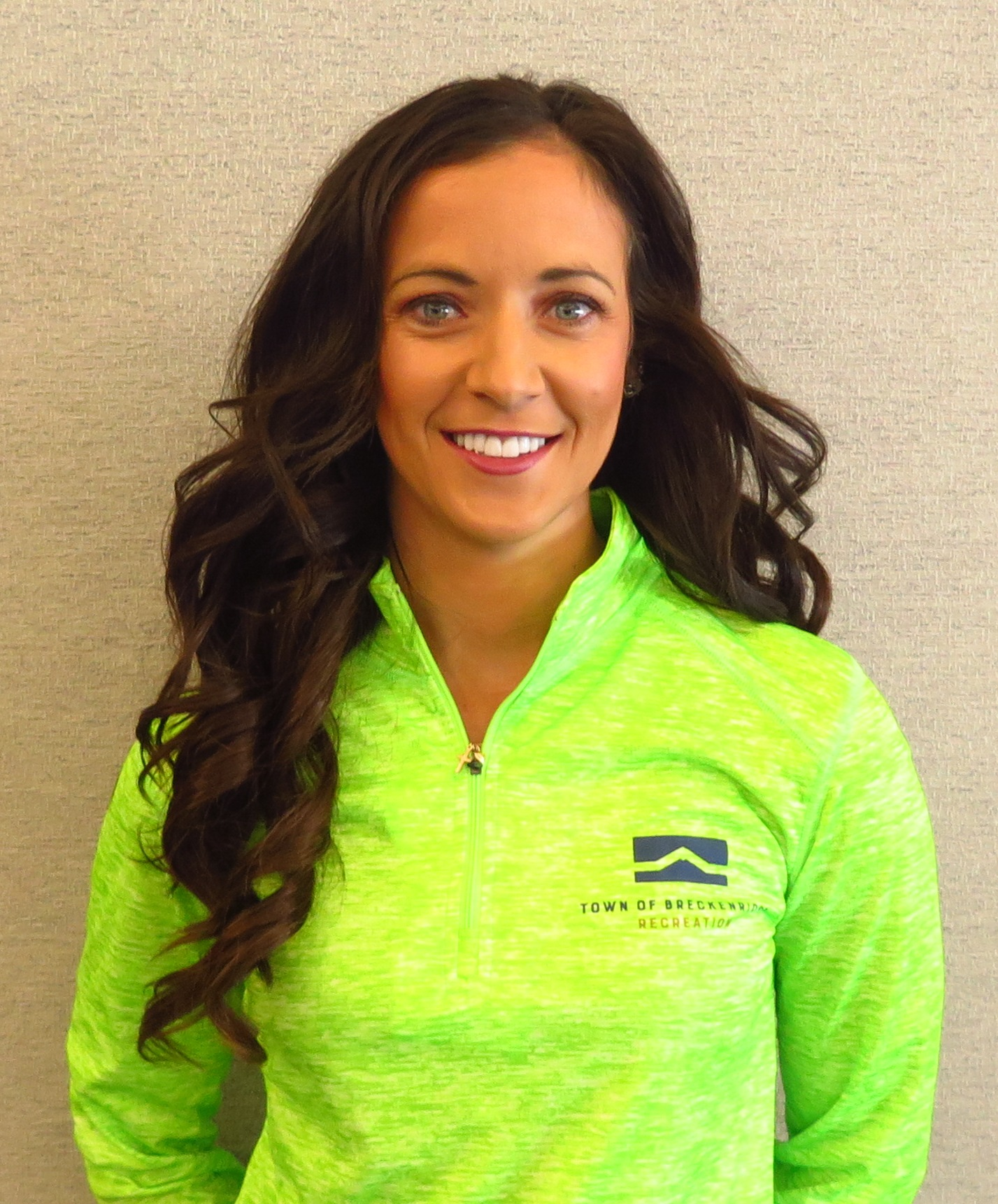 Head shot of Linzee Vito Breckenridge personal trainer in gree staff shirt