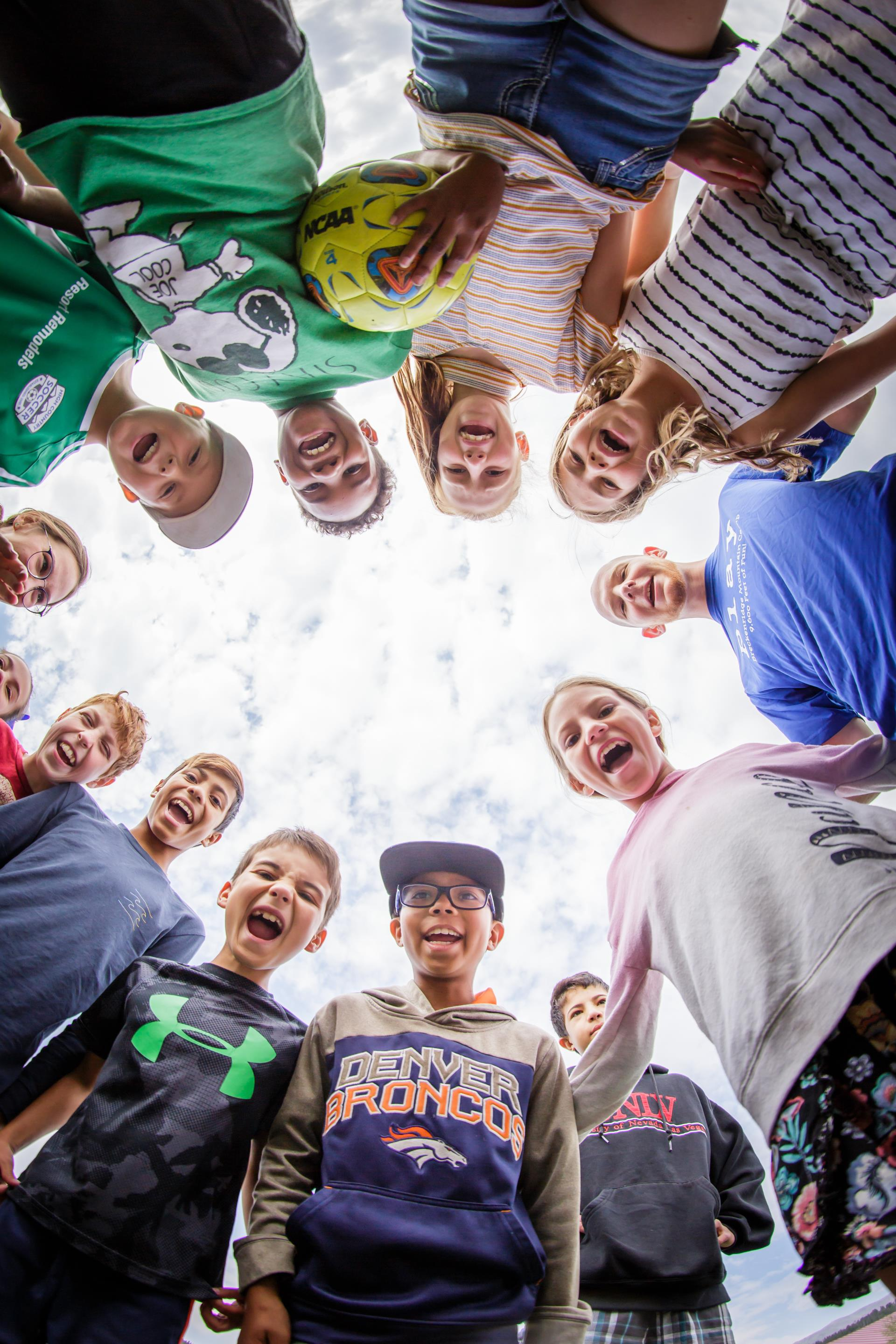 Upward view of children in a circle