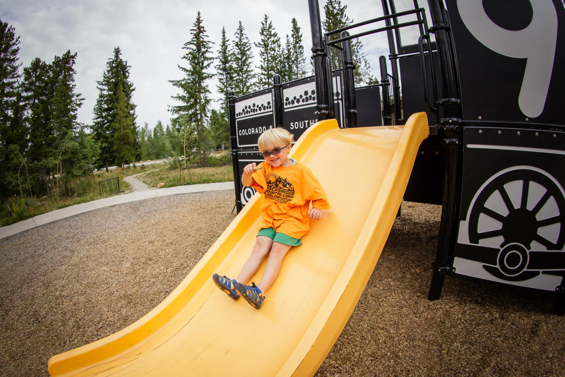 One young boy on slide at the Railroad Playground